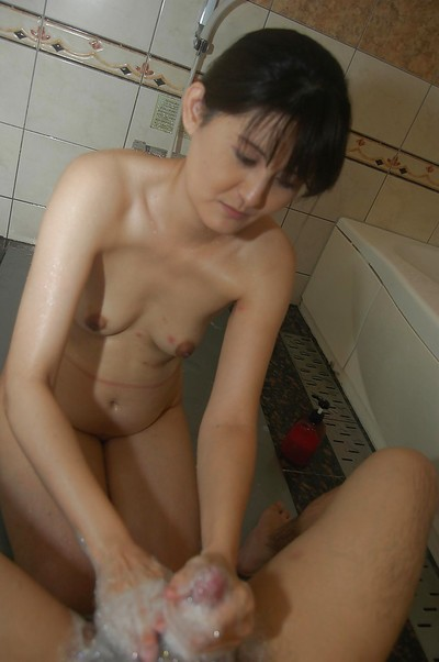 Sassy oriental MILF gives a soapy tugjob and blows a unyielding knob in the bath