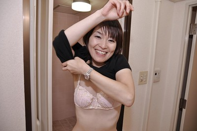 Sassy eastern MILF with mini zeppelins Miki Ando undressing and winsome bath