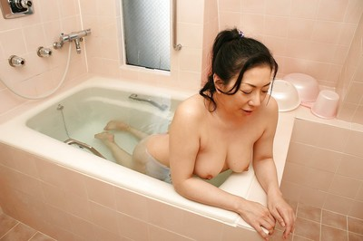 Sassy Japanese MILF Kumiko Yasue teasing her furry fur pie subsequently baths