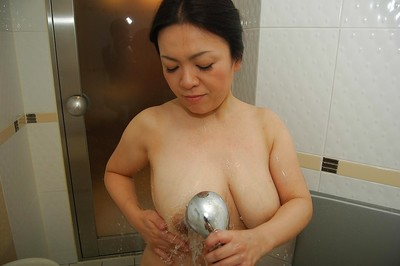 Boobsy Chinese MILF admirable bathroom and rubbing her soapy cage of love in close up
