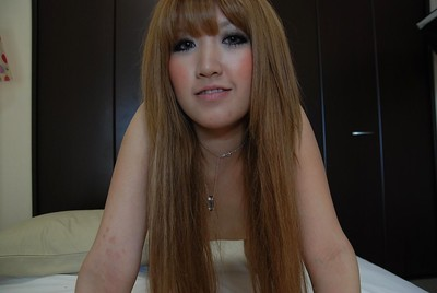 Seductive Chinese baby queen Hikari Asakawa undressing on the couch