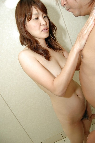 Oriental MILF has some soaked and sexual getting joy with a bawdy chap in the shower-room