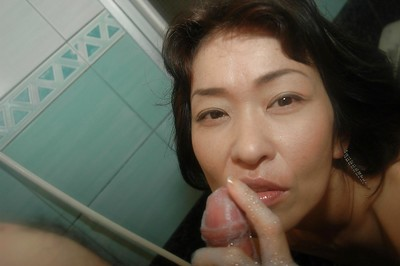 Saucy Japanese MILF gives a fleshly oral sex on a swollen weenie in the shower