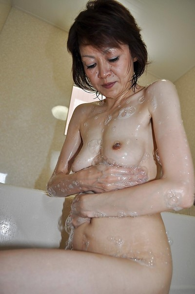 Willowy mellow oriental hotty Takako Kumagaya entrancing washroom and teasing her uterus