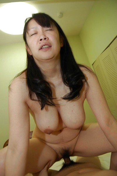 Hungry japanese MILF with enormous billibongs gains her unshaved pussy cocked up heavy