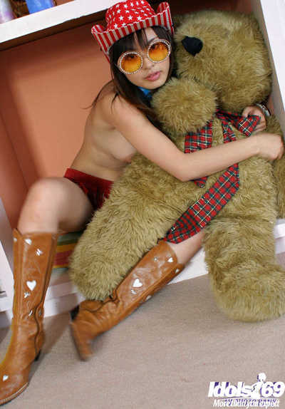 Gorgeous Japanese coed in boots uncovering her charming bends