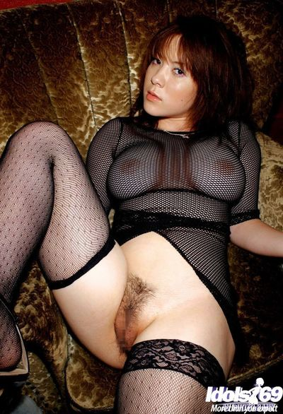 Bosomy eastern pretty with curly cum-hole posing in sheer outfit and