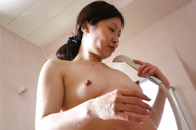 Lusty eastern MILF with raw tit buttons ravishing shower-room and rubbing her body