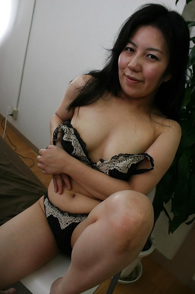 Liberated Chinese seasoned lady with shaggy gash getting rid of her underware
