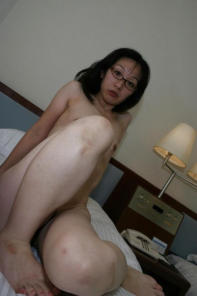 Lean eastern MILF in glasses undressing and exposing her cum-hole in close up