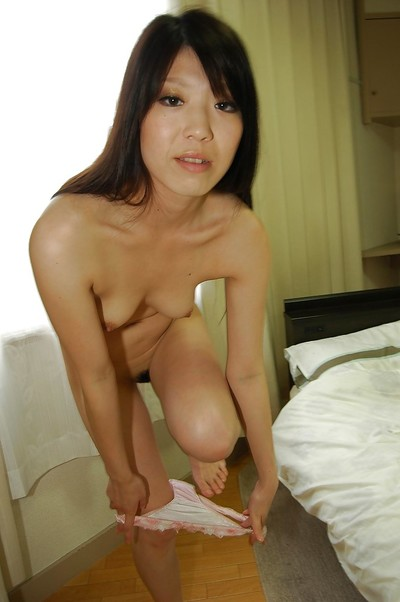Japanese cutie in tube undressing and expanding her clits in close up