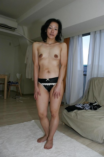Bawdy Chinese MILF Aya Sakuma undressing and exposing her holes