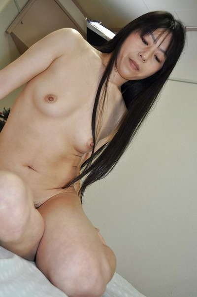 Sexual eastern MILF Yasuko Haraguchi vibing her curly cage of love subsequently shower-room