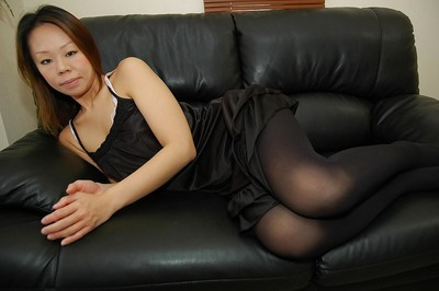 Chinese MILF Maki Shimazaki undressing and demonstrating her love-cage in close up