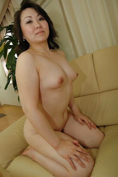 Oriental MILF receives rid of her underclothes and makes public her furry cum-hole
