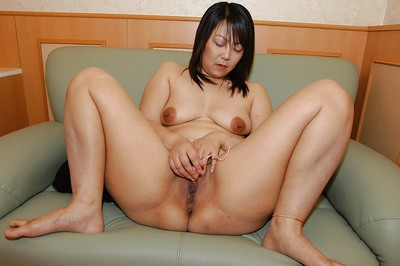 Bulky eastern MILF Rumi Yasumoto undressing and toying her love holes