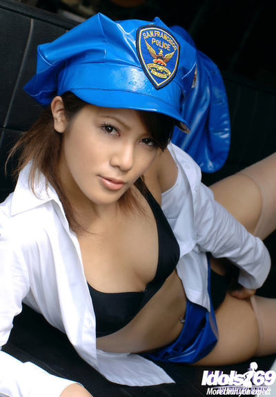 Spectacular oriental beauty with natty gazoo tempting off her police uniform