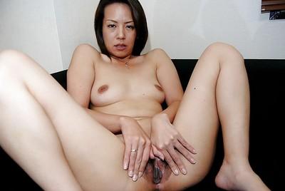 Skinny Japanese princess Hiroko Ebihara undressing and widening her legs