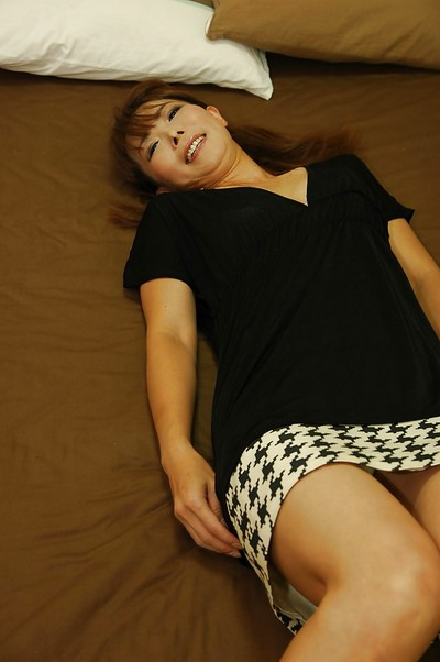 Dirty Japanese MILF Kayo Mukai undressing and posing as mother gave birth on the sofa