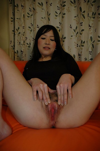 Lusty Chinese amateur Riho Iketani undressing and vibing her shaggy fur pie