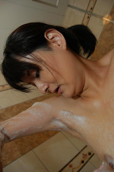 Sexual oriental MILF with hirsute gash and little scones pleasant bathroom