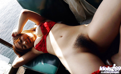 Pleasing Chinese coed uncovering her immense boobs and unshaved muff