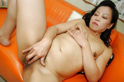 Chippy oriental MILF removes clothes down and has some snatch vibing having benefit from