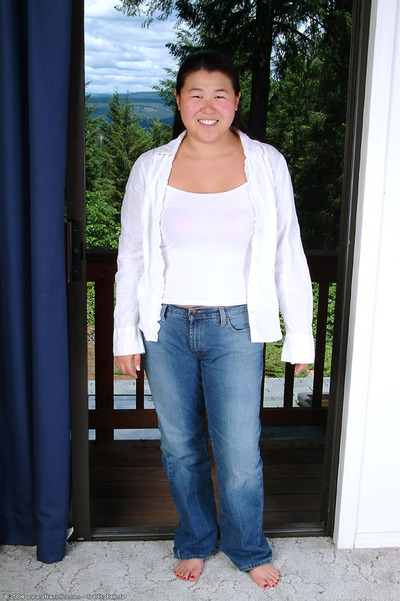 Youthful dark brown fatty sliding jeans and strings over huge Eastern gazoo