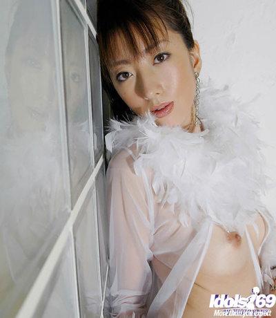 Beautiful Chinese angel with wild legs posing in white nylon nylons