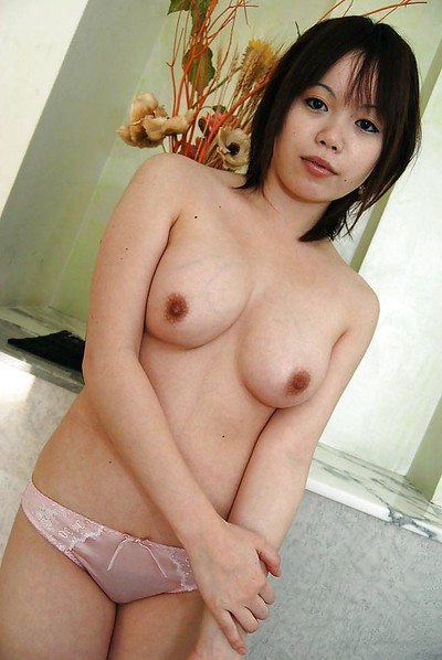 Fascinating Japanese cutie Yukari Fukada undressing and posing on the couch