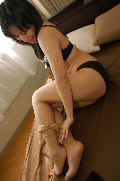 Japanese MILF Nagisa Takatsu undressing and exposing her captivating turns