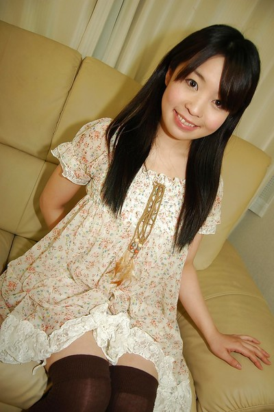 Smiley Japanese adolescent in nylons undressing and amplifying her hirsute clits