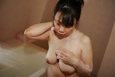 Heavy Japanese MILF with saggy meatballs takes bathroom and teases her hirsute twat