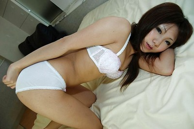 Charming oriental dear Megumi Kitigawa undressing and stretching her extreme legs