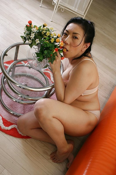 Massive eastern MILF Kimiko Yasue getting exposed and playing with her sex-toys