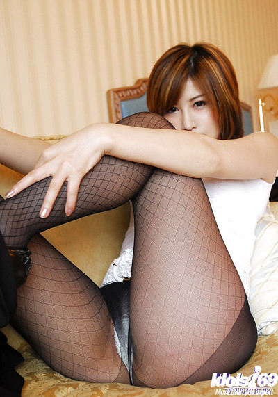 Seductive Chinese lady in hose gradually getting rid of her