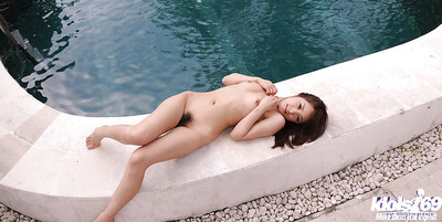 Splendid Japanese youthful with clever fanny striptease by the pool