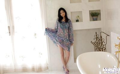 Joyful Japanese coed Aino Kishi ucovering her graceful body