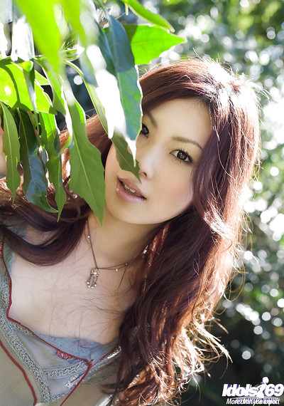 Seductive oriental vixen on high heels Ryo Shinohara posing outdoor
