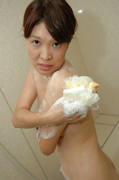 Chinese MILF Takako Yanase delightsome baths and exposing her wavy snatch