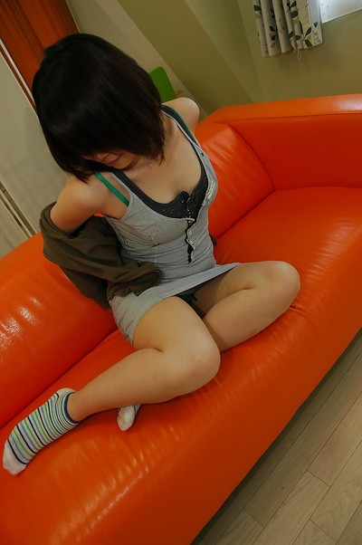 Smiley Chinese infant Maki Yoshikawa undressing and posing bare on the daybed