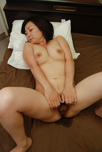 Dirty japanese MILF gives a titjob and attains her hirsute gentile boned-up