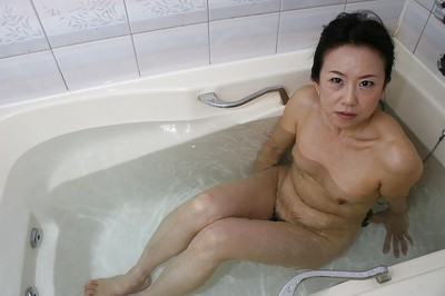 Grown Chinese lassie Junko Sakashita exposing her pink cage of love exactly after bathroom