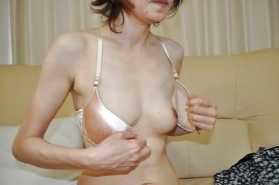 Shy melodious Chinese lady Takako Kumagaya undressing and expanding her legs