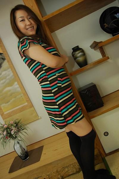 Oriental MILF in nylon knee socks Yuki Otomo undressing and posing naked