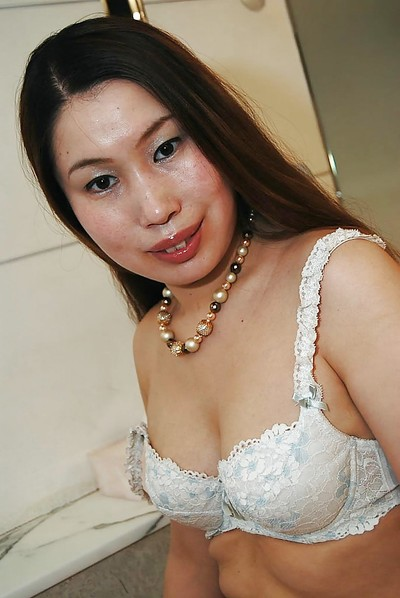 Eastern MILF Ayako Sakuma undressing and showcasing her soggy uterus in close up
