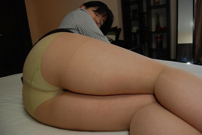 Japanese MILF undresses down and attains her wavy gentile positive by fake penis