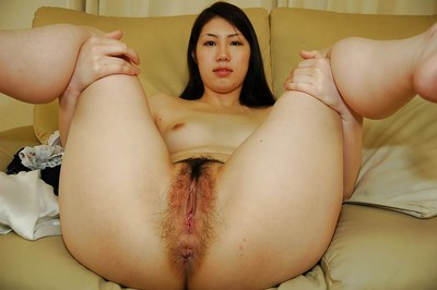 Shy eastern youthful undressing and exposing her unshaved gash in close up