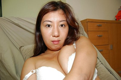 Shy Chinese sweetheart removes clothes down and has some uterus fingering enjoyment