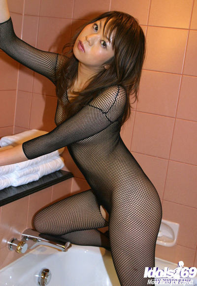 Thin Chinese cutie with insignificant boobs posing in cylinder clothing in the washroom